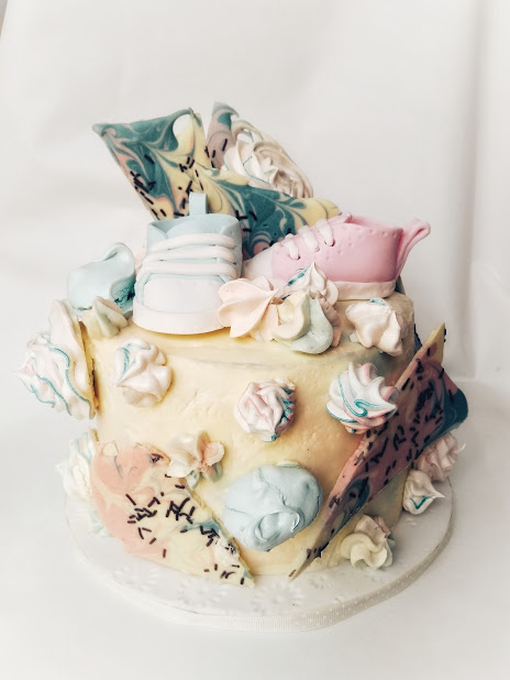 Baby shower bootee cake